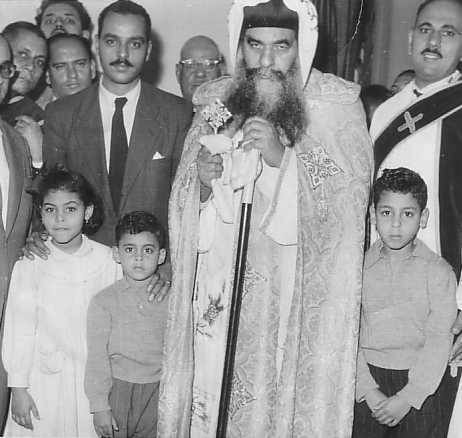 Fr Mina Nematalla and his family as a layman, not long before his ordination, together with his uncle, Pope Kyrollos VI.